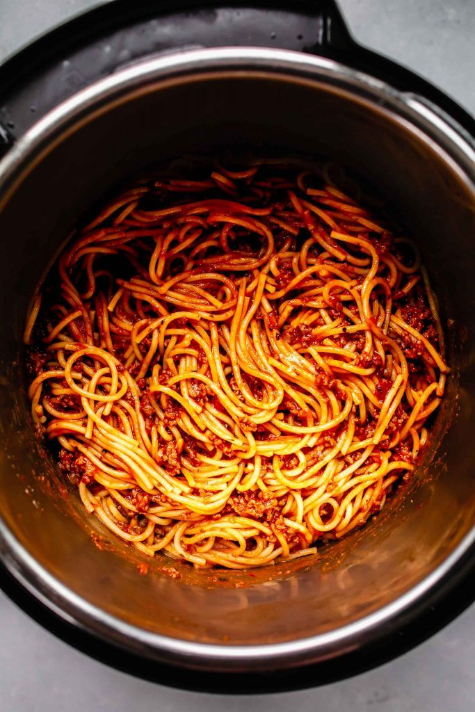 top shot of spaghetti cooking in pressure cooker